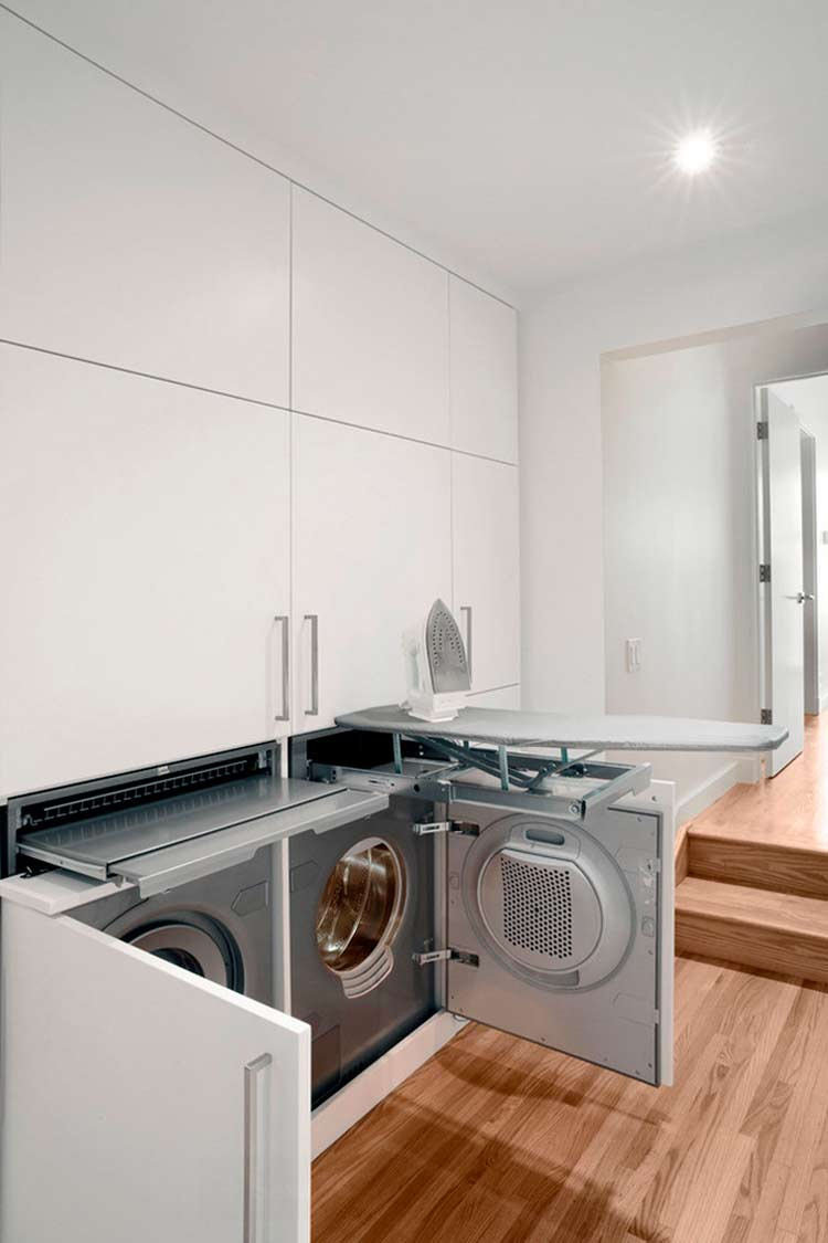 Built in laundry room with iron board