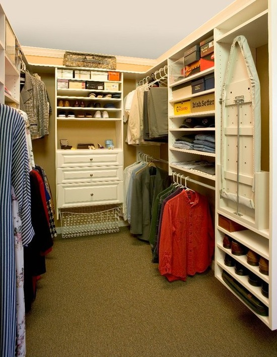 Master walk in closet featuring a ironing board