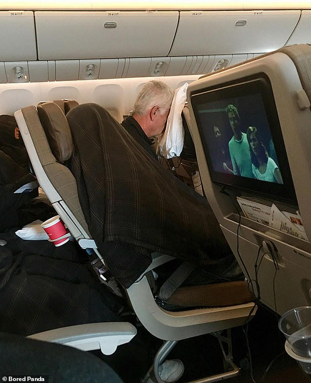 Passengers on board an 11-hour flight were amused to see one person sleeping with a blanket covering their face next to a man laying forward onto his pillow