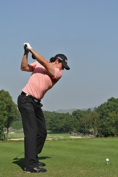 With his hands moving above his right shoulder, Rory McIlroy is on the proper swing plane during the 2011 Hong Kong Open.