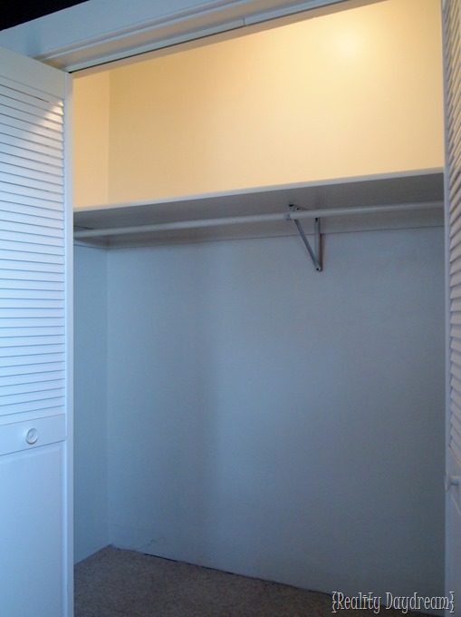 BEFORE shot of our builder-basic closet with SO MUCH WASTED SPACE! {Reality Daydream}
