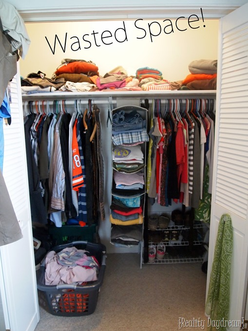 Those builder-basic closets with a single shelf are wasting SO MUCH SPACE. Above AND on the sides! Come see how to customize your closets with DIY Shelves to maximize storage! {Reality Daydream}