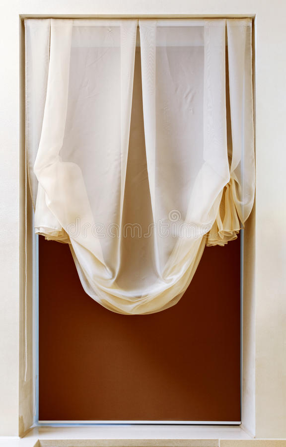 Art nouveau style curtain in window frame. Interior detail stock photo