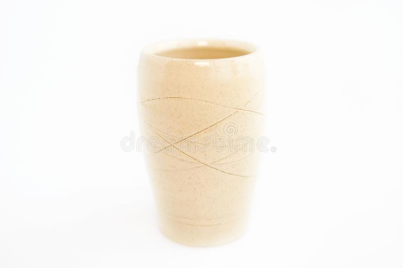 Beige vase on a white background. minimalism style. interior decoration. Beige vase on a white background. minimalism style. interior decoration royalty free stock photo
