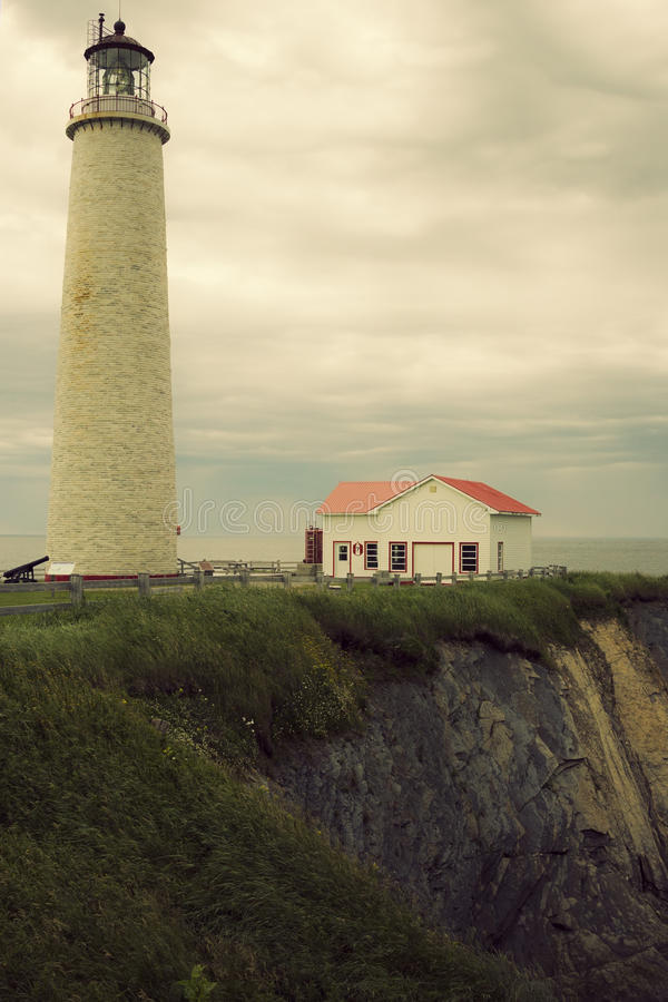 Cap des Rosiers Lighthouse in Quebec. On a cloudy morning stock image