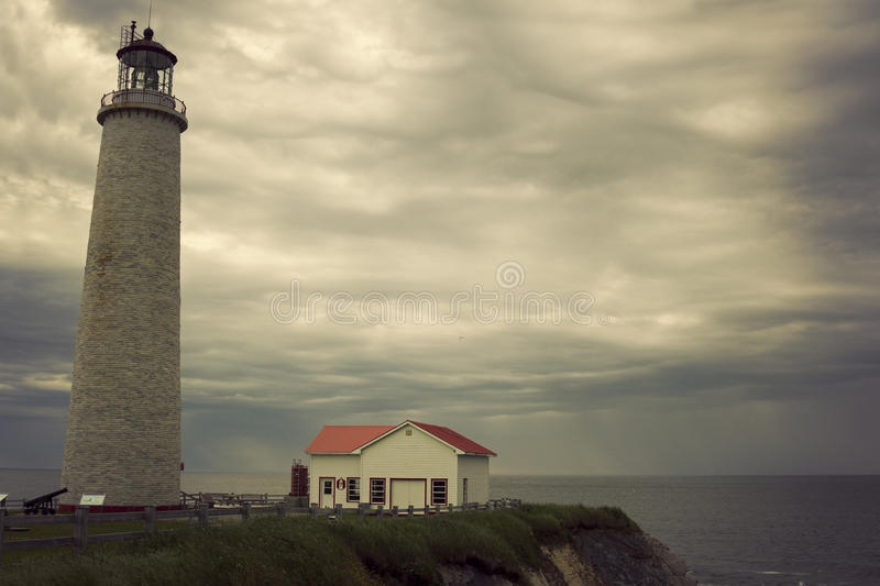 Cap des Rosiers Lighthouse in Quebec. On a cloudy morning royalty free stock images