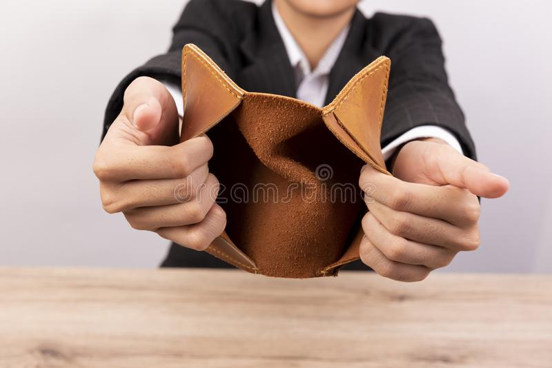 Close up of hand opens an empty wallet royalty free stock images