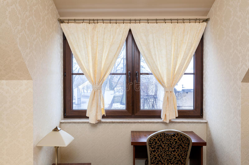 Decorative hangings in window. Decorative bright hangings in window in elegant room stock photo