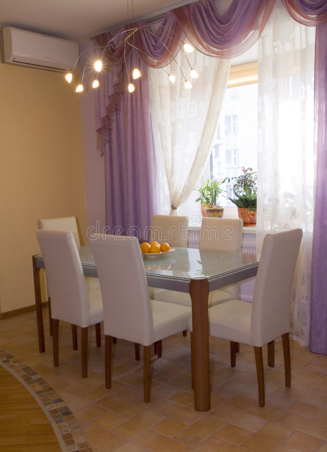 Dining-room. Stylish cozy dining-room designed in pastel colours royalty free stock photo