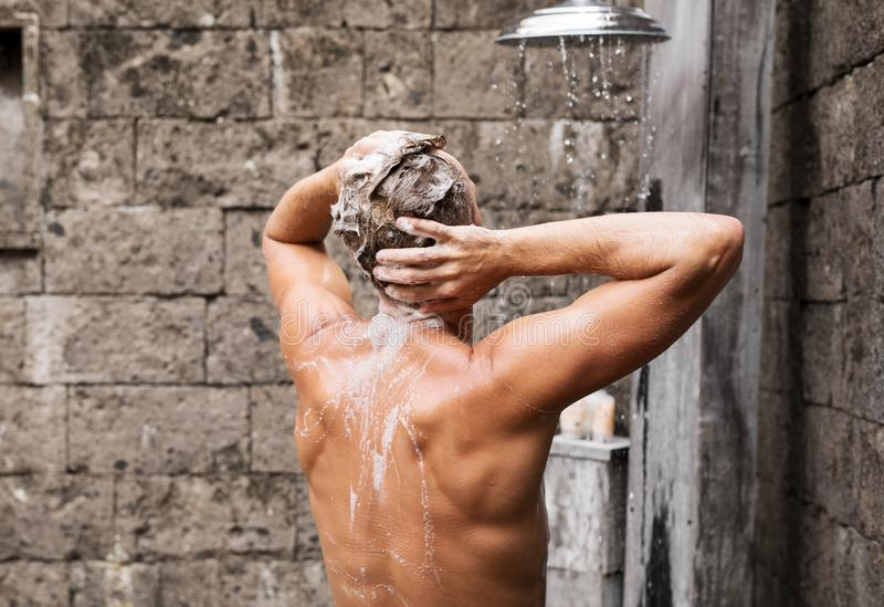 Man taking shower and washing hair. Handsome man taking shower and washing hair royalty free stock photos