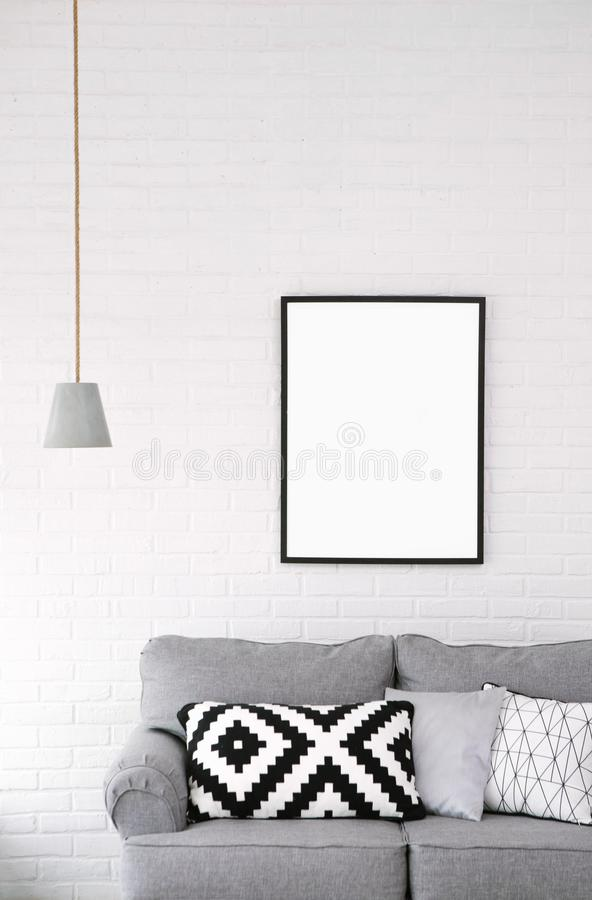 Room style minimalism sofa picture lamp interior. Interior decor room minimalism gray sofa cushions lamp big picture pillows on white background royalty free stock photo