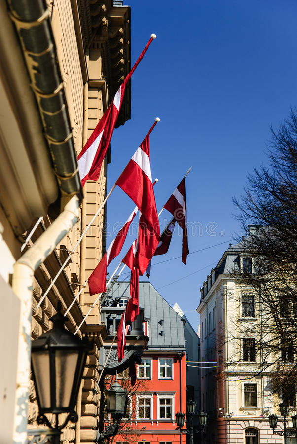 Latvian national flags at the old town of Riga, Latvia royalty free stock images