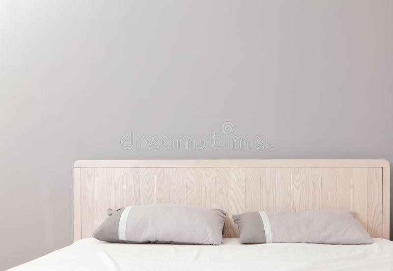 Modern double bedroom. With gray wall, great for copy space stock photography