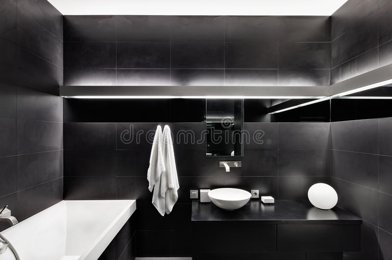 Modern minimalism style bathroom interior. In black and white tones royalty free stock photography