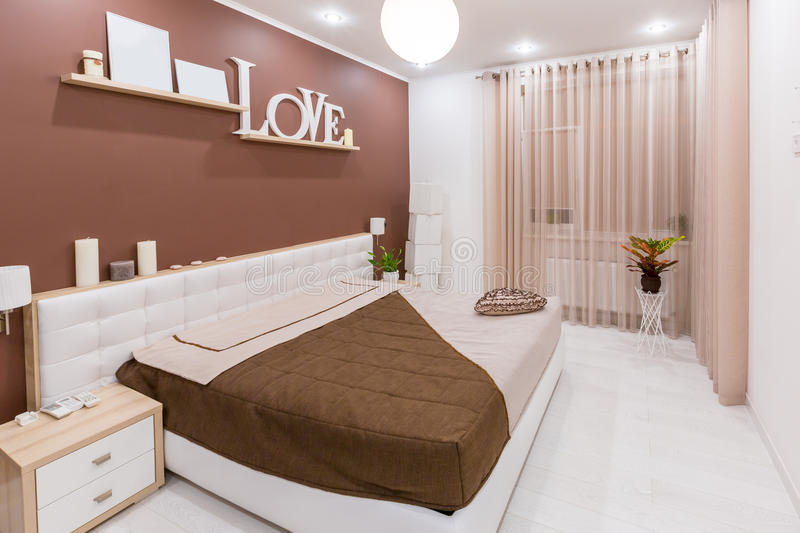 Modern minimalism style bedroom interior in light warm tones.  royalty free stock photos