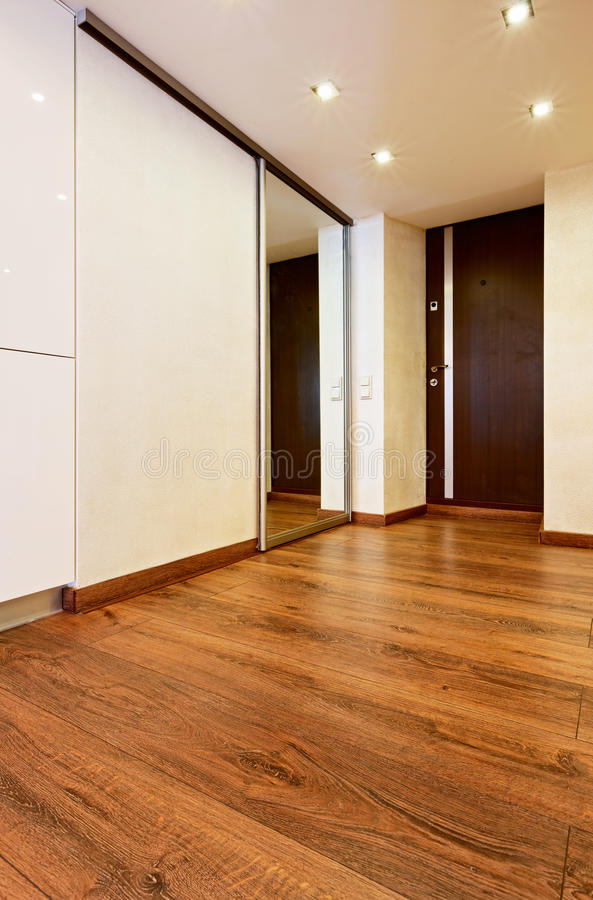 Modern minimalism style corridor interior. With sliding-door mirror wardrobe stock image