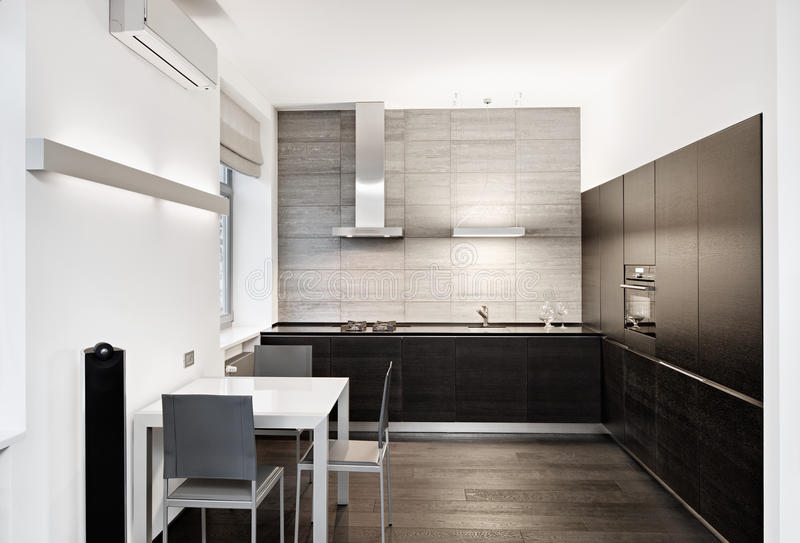 Modern minimalism style kitchen interior. In monochrome tones royalty free stock image