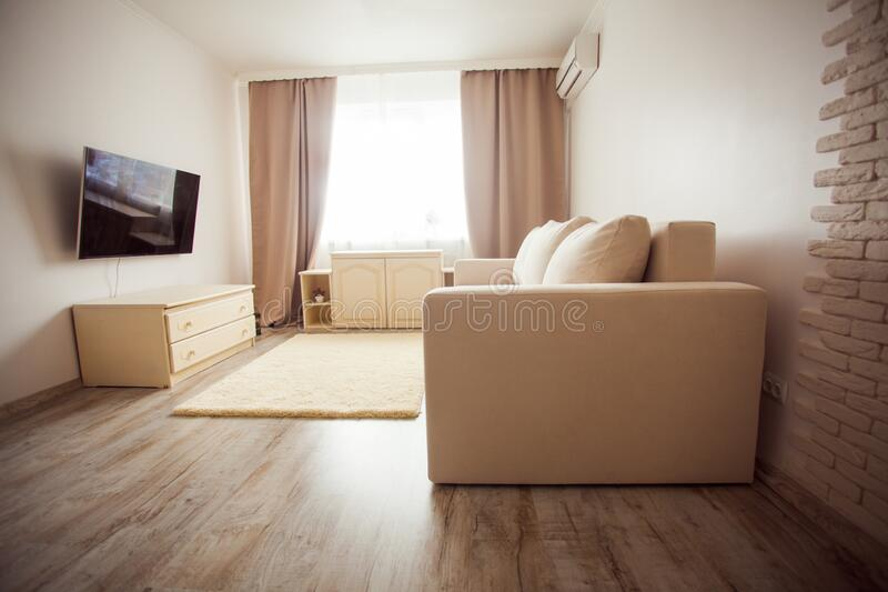 Modern minimalism style sitting room interior in beige tones stock photo