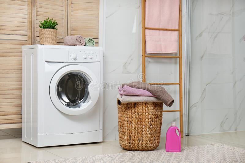 Washing machine and laundry in bathroom stock images