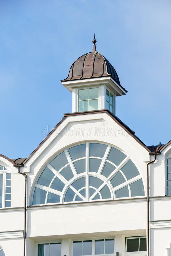 Modernized resort architecture. Building facade in a modernized resort architecture with arched windows and tower in Binz royalty free stock photography