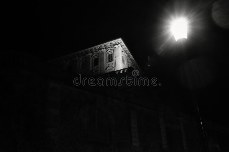 Old house immersed in darkness stock photo