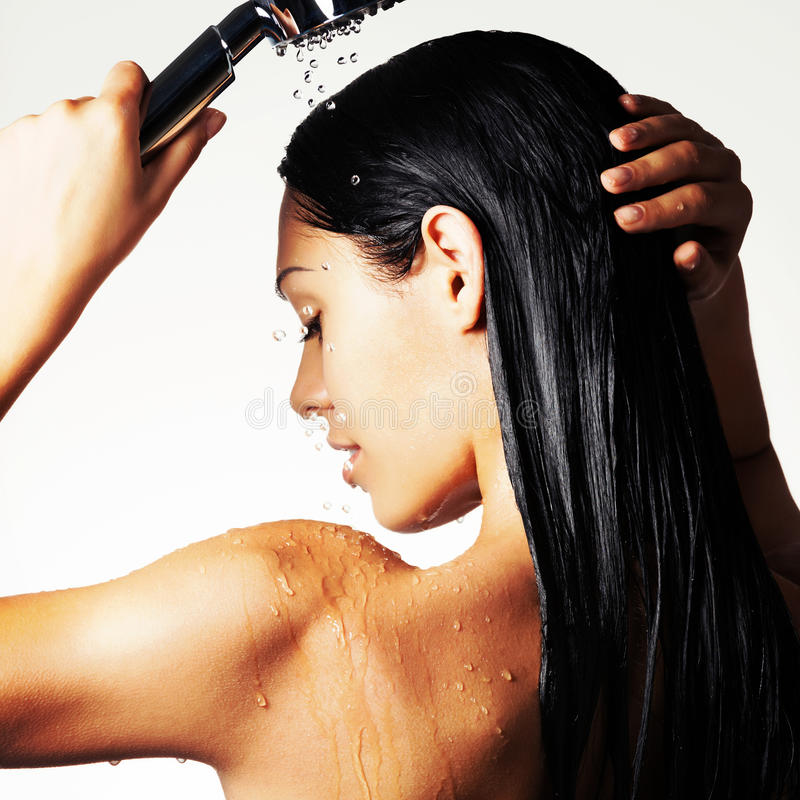 Photo of a woman in shower washing long hair stock photo