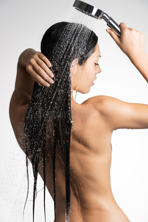 Photo of a woman in shower washing long hair stock images