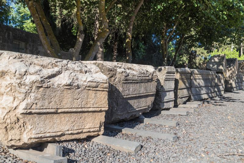 Remains of the upper cornice with elements of jewelry on the ruins of the Big Sinagogue of the Talmudic Period in Bar`am National. Park in Israel royalty free stock image