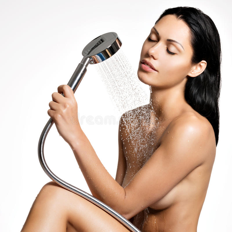 Beautiful woman in shower washing body. Photo of a beautiful woman in shower washing body royalty free stock images