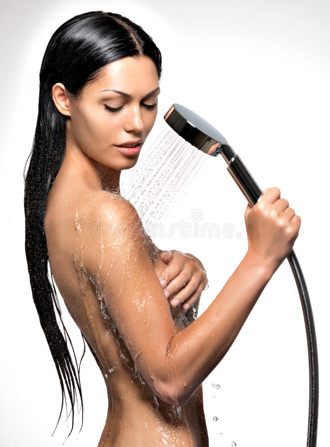 Beautiful woman in shower washing body. Photo of a beautiful woman in shower washing body stock image