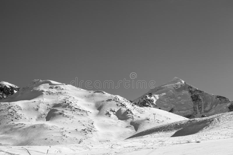Snowy mountain with glacier and slope for freeriding with snow cornice. At sun winter morning. Caucasus Mountains, Svaneti region of Georgia, Mount Tetnuldi royalty free stock photography