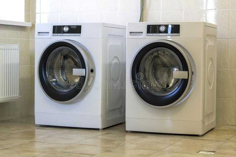 Two big washing machine in bathroom stock photos