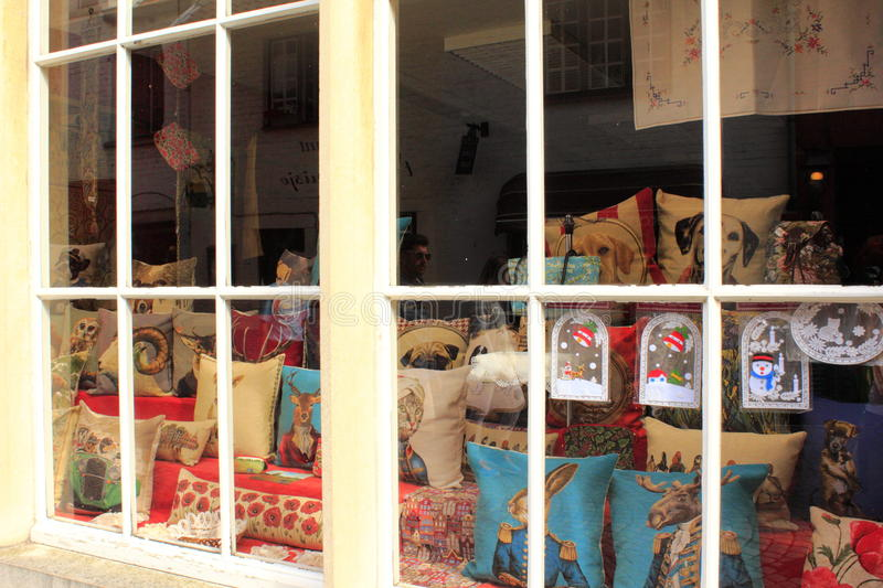 Typically Belgian cushions on shop window. Belgian tapestry cushions, tablemats, tapestry throws, bedspreads and shams, wall hangings, draught excluders and the stock photo