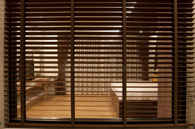 Vertical blinds. In the bedroom royalty free stock photography
