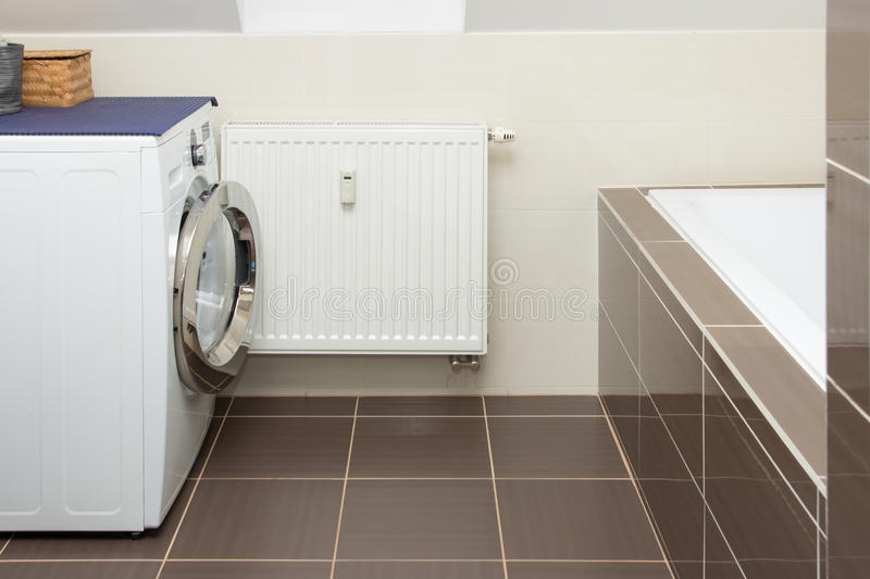 Washing machine in bathroom royalty free stock image