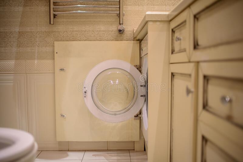 Washing machine in the bathroom, laundry concept royalty free stock photo