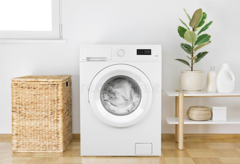 Washing machine with clothes in modern bathroom interior royalty free stock photography