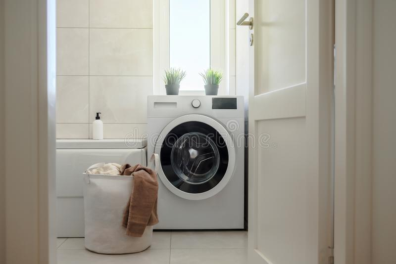 Washing machine in modern bathroom stock images