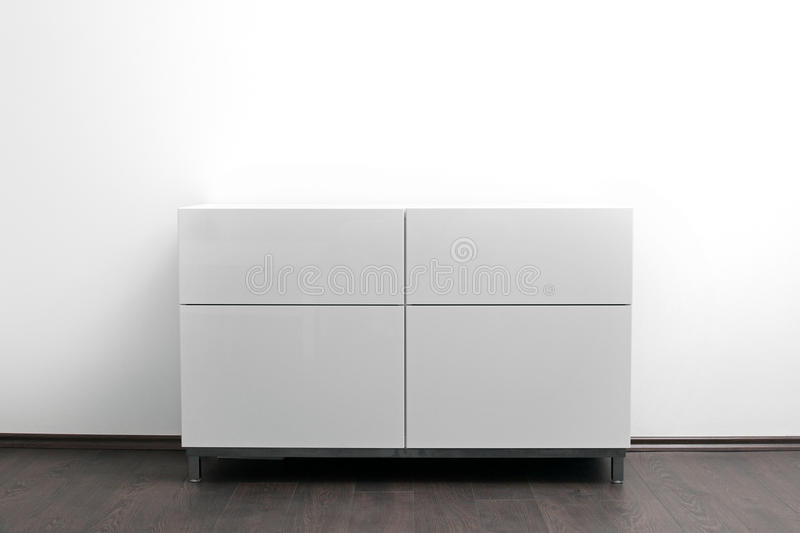 White chest of drawers in bright minimalism interior. White modern chest of drawers in bright minimalism interior stock photos
