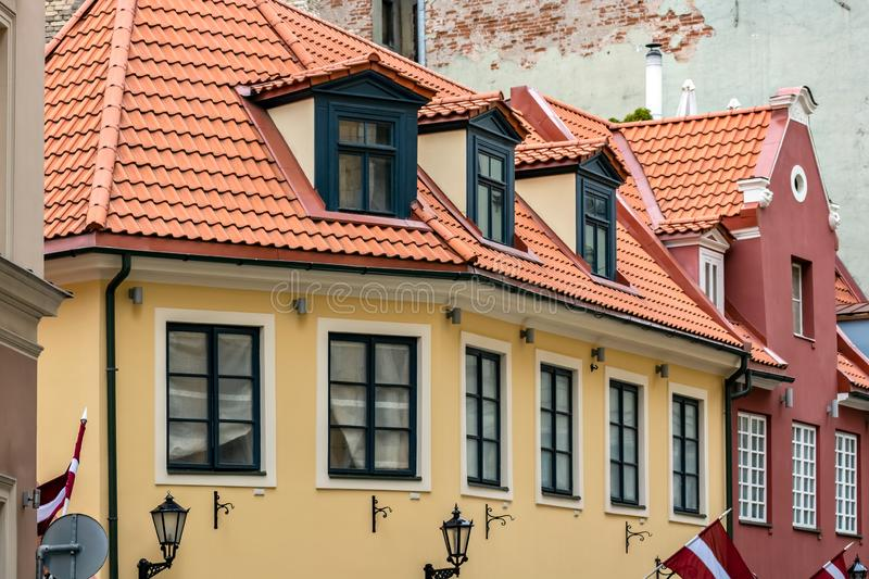 Yellow house with red roof stock photography